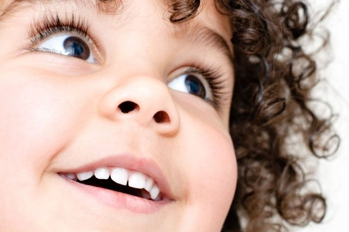iStock_000011886871XLarge-child-with-her-toothy-smile